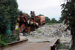 © Licensed to London News Pictures. 16/08/2015<br /> ABANDONED MACHINERY ON THE SITE.<br /> A mountain of waste still towers over local residents in St Pauls Cray,Orpington,Kent.  TODAY (16.08.2015)<br /> The residents of Cornwall Drive are still having to put up with a stinking smell,rats and fires coming from the  Waste4fuel site which is based at the end of the cul-de-sac.    The waste pile which is 40ft high can be clearly seen from Sidcup by-pass A20 and Crittalls Corner roundabout and is the first landmark visitors to the area are greeted with.<br /> <br /> <br /> (Byline:Grant Falvey/LNP)