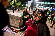 Environmental campaigners protest (some in owl masks to highlight using wood wisely) outside the 2nd anniversary investor meeting of the Green Investment Bank.  They are concerned about its support for the use of biomass as a fuel in power stations because it is from unsustainable sources. The meeting takes palce at the the offices of Bank of America Merrill Lynch, St Pauls, London 28 Oct 2014.