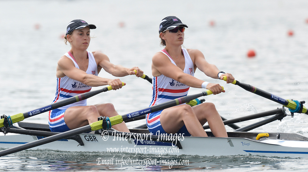 Trackai. LITHUANIA. GBR LW2X, Bow. Eleanor PIGGOTT and Charlotte BURGESS move away from the start in their morning heat in the lightweight women's double sculls on Lake Galve. 2012 FISA U23 Rowing Championships,  11:43:40 Thursday 12/07/2012 [Mandatory credit: Peter Spurrier/Intersport Images]..Rowing, U23, 2012.