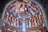 Interior Byzantine Romanesque style Christian frescoes of the central apse with Christ Pantocrator (in majesty) in a maodorla, Santissima Trinita di Saccargia, consecrated 1116 AD, Codrongianos, Sardinia. .<br /> <br /> Visit our MEDIEVAL PHOTO COLLECTIONS for more   photos  to download or buy as prints https://funkystock.photoshelter.com/gallery-collection/Medieval-Middle-Ages-Historic-Places-Arcaeological-Sites-Pictures-Images-of/C0000B5ZA54_WD0s<br /> If you prefer to buy from our ALAMY PHOTO LIBRARY  Collection visit : https://www.alamy.com/portfolio/paul-williams-funkystock/basilica-santissima-sardinia.html