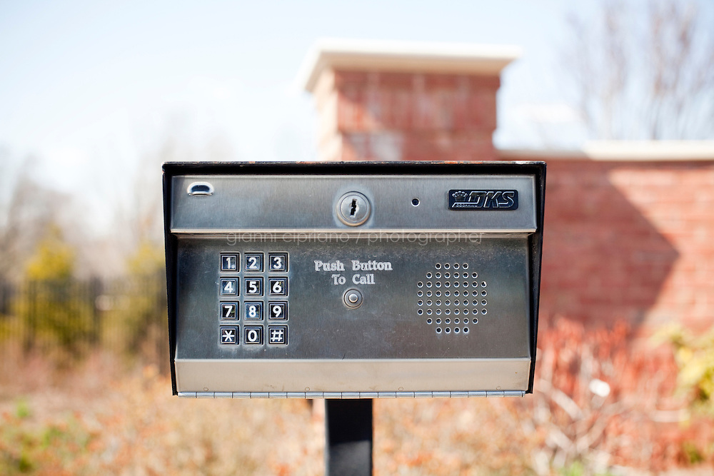 9 April, 2009. Brookville, NY. An entry phone at the entrance of a mansion in Dupont Court in Brookville, NY. Dupont Court is the area of Brookville with the most impressive residences of the village. The Gold Coast village of Brookville is the wealthiest community in the United States, according to a survey published Wednesday by BusinessWeek magazine.<br /> <br /> Brookville was one of nine Long Island communities to make the magazine's list of the country's 25 wealthiest towns, based on research by the Gadberry Group, of Little Rock, Ark.<br /> <br /> The village's mayor, Caroline Zimmermann Bazzini, said Brookville residents likely felt the pain of recession much less than most other folks.<br /> <br /> Brookville residents had the highest average net worth of any town on the list: $1.67 million. The enclave's well-to-do denizens had an average annual income of $328,000, ranking it seventh on the list.<br /> <br /> ©2009 Gianni Cipriano<br /> cell. +1 646 465 2168 (USA)<br /> cell. +1 328 567 7923 (Italy)<br /> gianni@giannicipriano.com<br /> www.giannicipriano.com