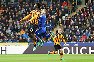 Hull City defender Ola Aina (34) and Cardiff City defender Joe Bennett (3) in the air together during the EFL Sky Bet Championship match between Hull City and Cardiff City at the KCOM Stadium, Kingston upon Hull, England on 28 April 2018. Picture by Mick Atkins.