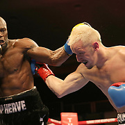VERONA, NY - JUNE 09:  Francy Ntetu (L) punches Brian Holstein during a ShoBox boxing match at the Turning Stone Resort Casino on June 9, 2017 in Verona, New York. (Photo by Alex Menendez/Getty Images) *** Local Caption *** Francy Ntetu; <br /> Brian Holstein