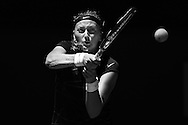 PERTH, AUSTRALIA - DECEMBER 29: (EDITORS NOTE: Image has been converted to black & white) Petra Kvitova of the Czech Republic plays a forehand to Anabel Medina Garrigues of Spain in the women's singles match during day two of the Hopman Cup at Perth Arena on December 29, 2013 in Perth, Australia.  (Photo by Paul Kane/Getty Images)