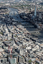 © Licensed to London News Pictures. 26/04/2016. London, UK. Aerial view looking towards Tower Bridge along the Thames, including St Pauls Cathedral and The Shard. Photo credit: Martin Apps/LNP