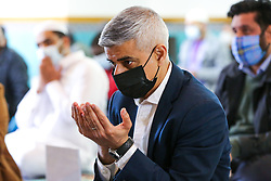© Licensed to London News Pictures. 30/04/2021. London, UK. Sadiq Khan, Mayor of London, wearing a face covering joins muslim devotees for Friday prayers during the Islamic holy month of Ramadan at the London Islamic Cultural Society and Mosque, also known as Wightman Road Mosque in Haringey, north London. The Mayor of London and the devotees are two meters apart and keeping to the rules of social distancing. Muslims across the world are observing the holy fasting month of Ramadan, a month long celebration with prayers, readings from the Koran and meeting with family and friends, as they abstain from eating, drinking and smoking from dawn till dusk. Sadiq Khan is running for re-election as London Mayor. Photo credit: Dinendra Haria/LNP