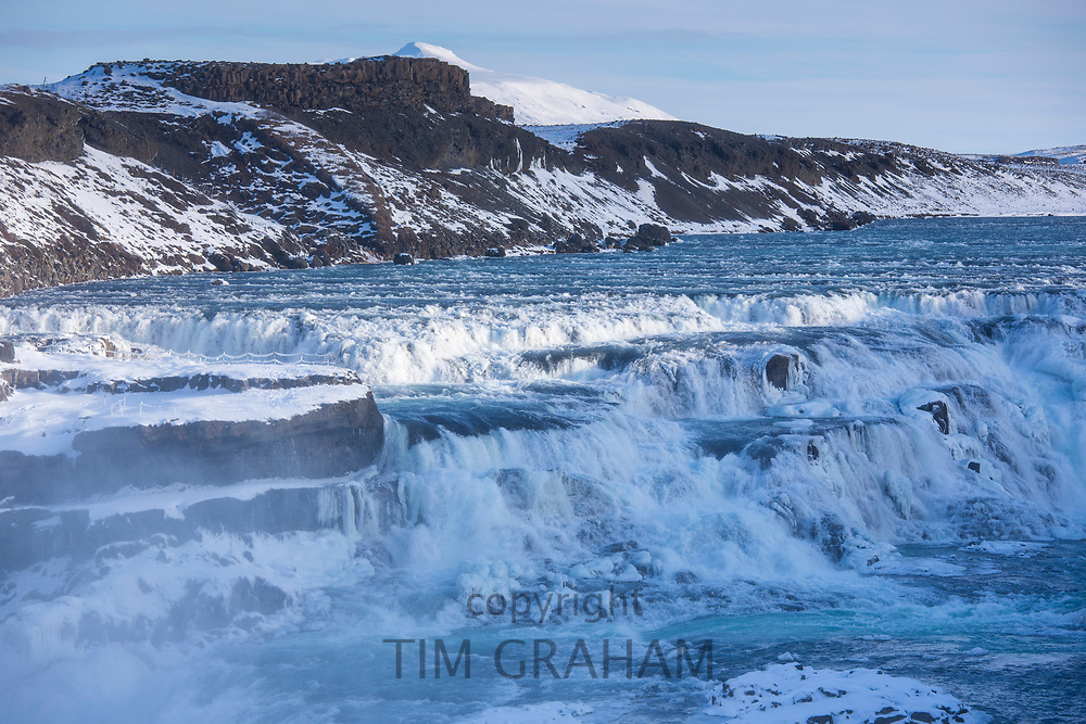 Gushing, flowing water of glacial river at thundering falls of Gullfoss Waterfall in glacial landscape of South Iceland