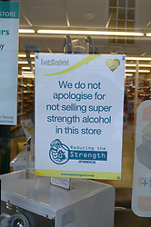 Sign apologising for not selling super strength alcohol, Co-Op, Woodbridge, Suffolk
