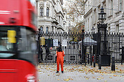 """A demonstrator wearing an orange suit and black bag in his head supporting Julian Assange and Khaled El-Masri holds a placard outside Downing Street to Protest against trial of Julian Assange in London, on Wednesday, Nov 11, 2020.  (VXP/ Vudi Xhymshiti)<br /> Assange is an Australian editor, publisher, and activist who founded WikiLeaks in 2006. WikiLeaks came to international attention in 2010 when it published a series of leaks provided by U.S. Army intelligence analyst Chelsea Manning. After spending almost seven years inside the embassy, Assange was arrested by British police on 11 April 2019. It came after Ecuadorean President Lenín Moreno tweeted that his country had taken """"a sovereign decision"""" to withdraw his asylum status.<br /> <br /> El-Masri a German and Lebanese citizen who was mistakenly abducted by the Macedonian police in 2003, was handed over to the U.S. Central Intelligence Agency."""