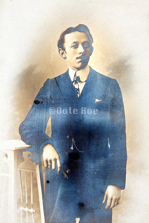 silver mirroring vintage photo with portrait of an adult man in studio setting