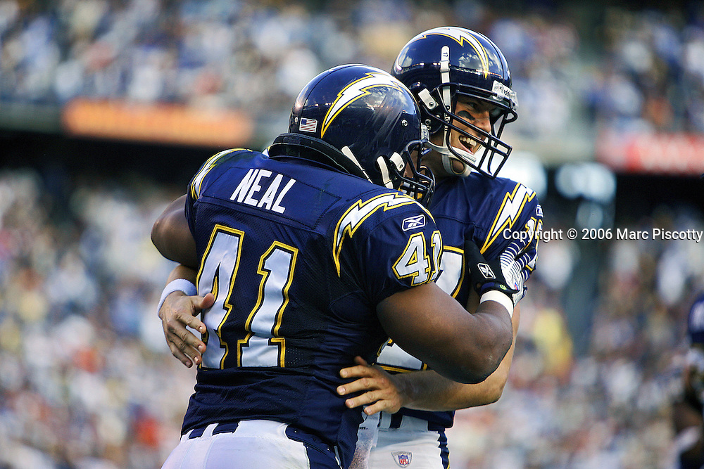 In the first quarter, the San Diego Chargers Philip Rivers (#17, QB) celebrates with teammate Lorenzo Neal (#41, FB) after Neal scored on a four yard run to go up 14-0 at that point at QUALCOMM Stadium in San Diego, Ca. on Sunday December 10, 2006. The Broncos lost the game 48-20..(MARC PISCOTTY/ © 2006)