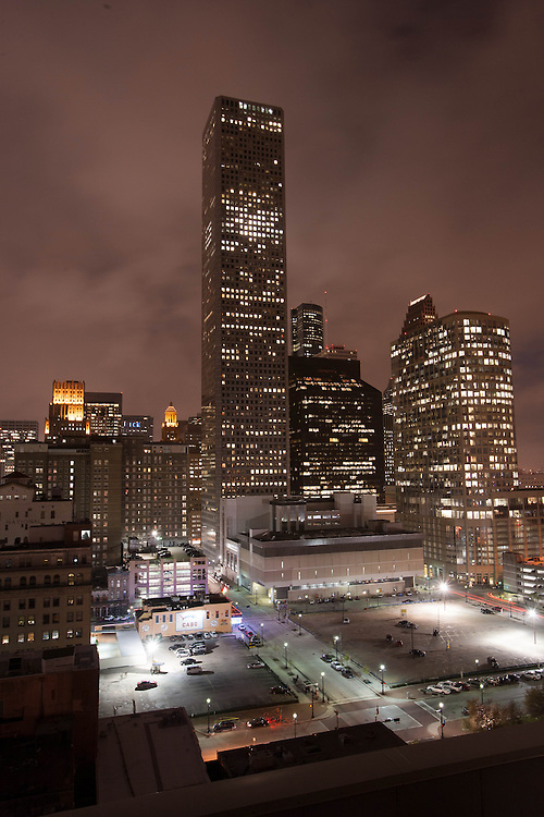Houston, Texas skyscrapers in the downtown central business district at night.