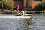 Police boat on Thames River, London, UK