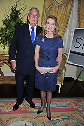 LADY MARY GAYE CURZON and DAVID McDONOUGH at Ambassador Earle Mack's 60's reunion party held at The Ritz Hotel, London on 18th June 2012.