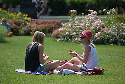 © licensed to London News Pictures. London, UK 17/07/2013. People enjoying the sunshine and hot weather in Jubilee Gardens, London on Wednesday, 17 July 2013. Photo credit: Tolga Akmen/LNP