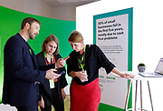 Intuit Executive Vice President and General Manager of Small Business and Self-Employed Group Alex Chriss, left, demonstrates the company's new product innovations at QuickBooks Connect 2019 on Thursday, Nov. 7, in San Jose, Calif. (Alison Yin/AP Images for Quickbooks)
