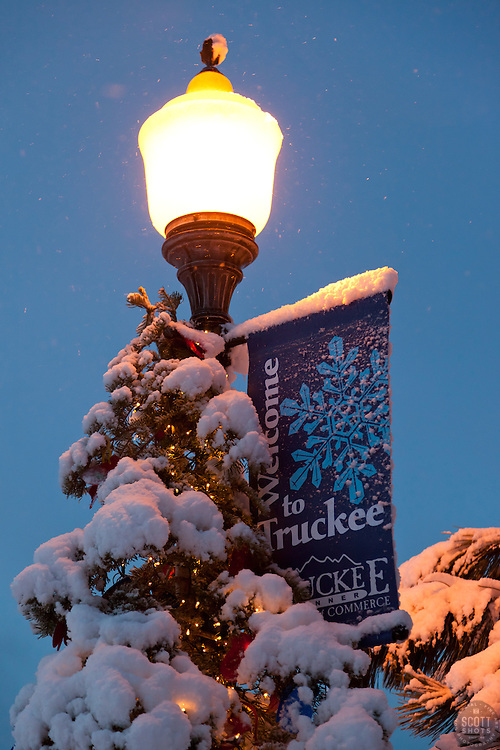 """""""Welcome to Snowy Truckee"""" - This snow covered welcome sigh and Christmas tree were photographed in historic Downtown Truckee, CA."""