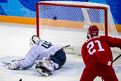 16-02-2018 KOR: Olympic Games day 7, PyeongChang<br /> Ice Hockey Russia (OAR) - Slovenia / Goal....forward Sergei Kalinin #21 of Olympic Athlete from Russia, goaltender Luka Gracnar #40 of Slovenia