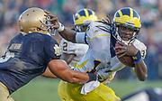University of Michigan quarterback Denard Robinson stiff arms Notre Dame linebacker Manti Te'o and breaks free for a long gain at Notre Dame Stadium in South Bend, Indiana.  Michigan beat Notre Dame 28-24.