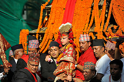 September 15, 2016 - Kathmandu, Nepal - Devotees carrying Goddess 'Kumari' for the chariot pulling festival on the third day of Indra Jatra Festival celebrated at Basantapur Durbar Square, Kathmandu. Devotees celebrated the god of rain 'Indra' for 8 days in Kathmandu. (Credit Image: © Narayan Maharjan/Pacific Press via ZUMA Wire)
