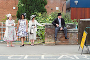 © Licensed to London News Pictures. 19/06/2014. Ascot, UK. A man sits on a wall. Day three, Ladies Day, at Royal Ascot 19th June 2014. Royal Ascot has established itself as a national institution and the centrepiece of the British social calendar as well as being a stage for the best racehorses in the world. Photo credit : Stephen Simpson/LNP