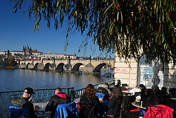 November 18, 2018 - Prague, Czech Republic - Tourists enjoy the warm weather in central Prague, Czech Republic. In the background is Charles Bridge and Prague Castle. (Credit Image: © Slavek Ruta/ZUMA Wire)