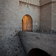 Indirect light beams through this gateway into old Valencia, Spain.