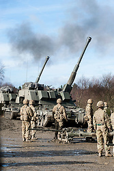 L118 crews watch as the Royal Artillery AS90 155mm Self Propelled guns live fire beside them during exercise Steel Sabre. A large Scale military live fire exercise on Otterburn Training Area it involves 1400 troops the majority from the Royal Artillery 1st Artillery Brigade and brings all the components of an effective Artillery group together to train in delivering firepower on the battlefield.<br /> <br />   02 March 2017 <br />   Copyright Paul David Drabble<br />   www.pauldaviddrabble.co.uk