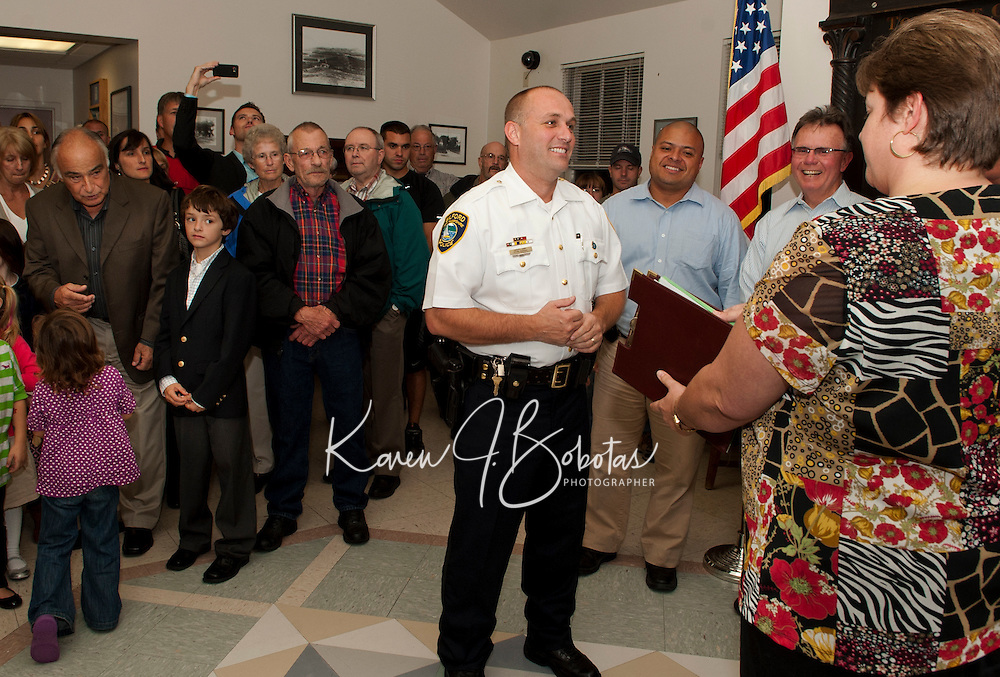 Family and friends gather at Town Hall Monday evening as Town Clerk Denise Gonyer prepares for the swearing in of Gilford Police Chief Kevin Keenan.  (Karen Bobotas/for the Laconia Daily Sun)