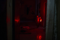 August 1, 2018 - Gaza City, The Gaza Strip, Palestine - A Palestinian girl carrying a lamp in her house during a power cut in the Jabalya refugee camp in the northern Gaza Strip. (Credit Image: © Mahmoud Issa/Quds Net News via ZUMA Wire)