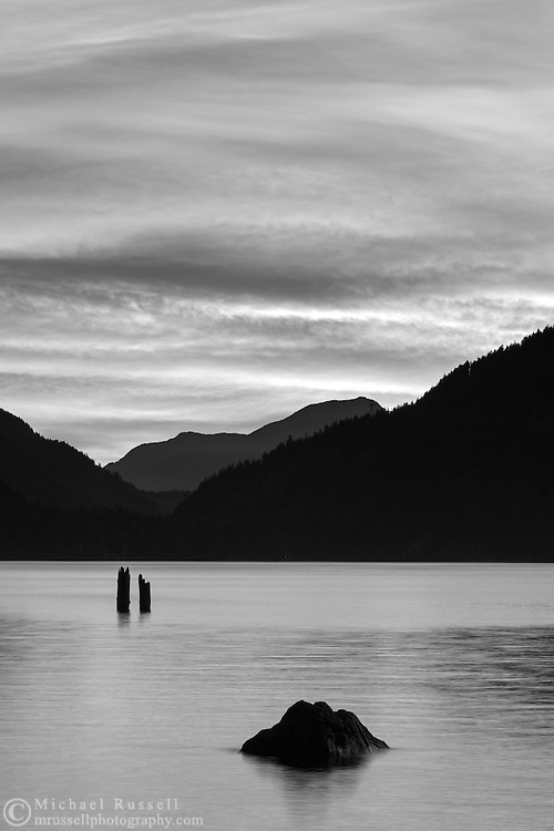 An evening sunset in Black and White at Harrison Lake near Harrison Hot Springs, British Columbia, Canada. The distant mountain peak to the west is Sasin Peak.