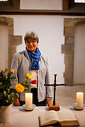 Woman pastor Andrea Pfeifer from the German Evangelical Church which is using St. Martin in the Wall (Czech: Kostel sv. Martina ve zdi) for their church services on Sundays. In 1414, when in the end of October the local pastor Jan from Hradec incited by M. Jakoubek from Stříbro for the first time served the altar sacrament in both kinds to laymen. In the following years the chalice became the symbol of the Hussite revolution.