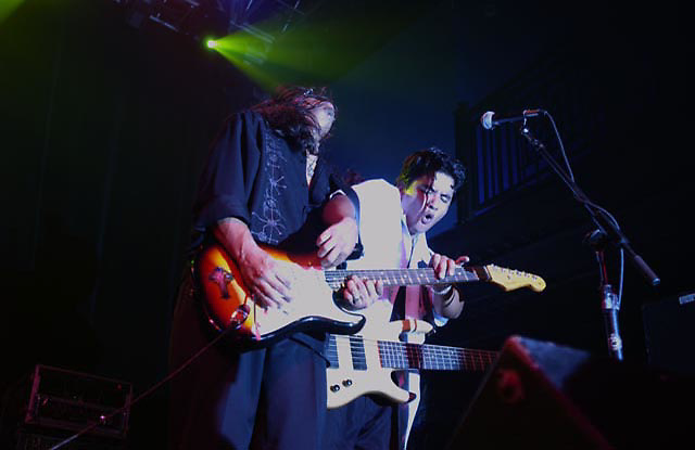 Henry and JoJo Garza of Los Lonley Boys, an American musical group from San Angelo, Texas, that plays a style of Tex-Mex rock, with elements of blues, soul, country, and Tejano, play at the 9:30 Club on Monday June 7, 2004.