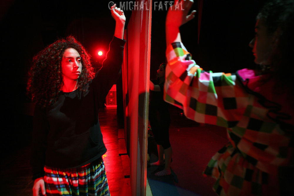 """Members of The Palestinian Circus School practice before going on stage, as they prepare to perform the show """"Circus behind the wall"""" in Ramallah, November 20, 2009.The circus group was established in 2006, in order to give a new way of expression for Palestinians, and a new way to deliver the idea of resistance to the occupation. This performance is based on the life of Palestinians behind the separation wall. Photo by Michal Fattal/backyard"""