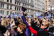 "New York, NY - 24 March 2019. Senator Kirsten Gillibrand (D-NY) held a presidential campaign rally on New York's Central Park West in Front of the Trump Hotel  and Tower. The crowd holds ""2020 Gillibrand"" signs in the air."