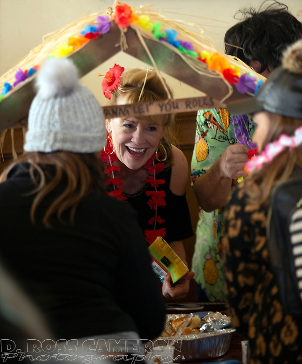"""Rae Fleming of Santa Cruz, Calif., center, dispenses some of her """"Come On I Want to """"Lei"""" You Rolls"""" at the 21st annual Spam Festival, Sunday, Feb. 17, 2019, in Isleton, Calif. Spam lovers compete for prizes by presenting their favorite Spam-infused foods, or entering the Spam-eating and Spam-toss contests. (Photo by D. Ross Cameron)"""