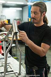 Lock Baker puts the finishing touches on a frame Will Ramsey fabricated to his specifications for his custom Out of Justice. Lock's shop, Los Angeles, CA, USA. Thursday, June 21, 2018. Photography ©2018 Michael Lichter.