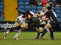Photo: Rich Eaton.<br /> <br /> Sale Sharks v Bristol Rugby. Guinness Premiership. 01/01/2007. Lee Robinson left of Bristol tackles #6 JM Fernandez Lobbe of Sale
