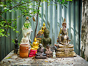 11 MAY 2017 - BANGKOK, THAILAND: Statues of the Buddha behind a home in Pom Mahakan. The final evictions of the remaining families in Pom Mahakan, a slum community in a 19th century fort in Bangkok, have started. City officials are moving the residents out of the fort. NGOs and historic preservation organizations protested the city's action but city officials did not relent and started evicting the remaining families in early March.         PHOTO BY JACK KURTZ