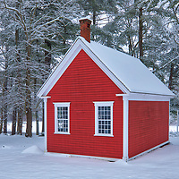 The Little Red Schoolhouse historical landmark at the historic Longfellow's Wayside Inn Historic District in Sudbury Massachusetts covered in a snowy winter wonderland.<br /> <br /> New England country photography images of the Longfellow's Wayside Inn outhouse behind the Little Red Schoolhouse are available as museum quality photo, canvas, acrylic, wood or metal prints. Wall art prints may be framed and matted to the individual liking and interior design decoration needs:<br /> <br /> https://juergen-roth.pixels.com/featured/the-little-red-schoolhouse-juergen-roth.html<br /> <br /> Good light and happy photo making!<br /> <br /> My best,<br /> <br /> Juergen