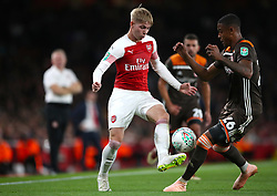 Arsenal's Emile Smith-Rowe (left) and Brentford's Ezri Konsa battle for the ball during the Carabao Cup, Third Round match at the Emirates Stadium, London.
