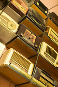 Close up of merchandise with old radios displayed in antique market in Casablanca, Morocco