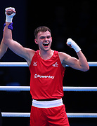 Lewis Richardson of Great Britain  (red) celebrates beating Victor Yoka of France (bue) in the Men's Middleweight preliminaries during The Road to Tokyo European Olympic Boxing Qualification, Sunday, March 15, 2020, in London, United Kingdom. (Mitchell Gunn-ESPA-Images/Image of Sport)