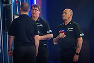 Referee Russ Bray (right) during the William Hill World Darts Championship at Alexandra Palace, London, United Kingdom on 28 December 2020.