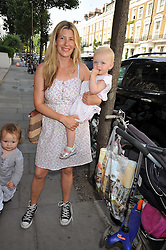SARA PARKER BOWLES and her daughter LOLA at the 10th anniversary party of the store Caramel, Ledbury Road, London W11.  The party was held in association with the Naked Heart Foundation - a charity set up by model Natalia Vodianova.