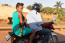 Woman And Child On Motorcycle Taxi