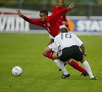 Football,  22. july 2002, Oslo. European under 19 Championship.  Germany v England. Jerome Thomas, England and Arsenal, and Matthias Lehmann, Germany (16).