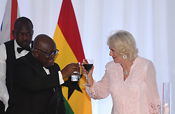The Duchess of Cornwall toasts with Ghanaian President Nana Akufo-Addo during a State Dinner at Jubilee House, in Accra, Ghana, on day six of the royal trip to west Africa.