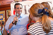 U.S. Senator and GOP presidential candidate Ted Cruz leads his daughters Catherine, 4, right, and Caroline, 7, in singing happy birthday to his wife Heidi Cruz during a campaign event at the Liberty Tap Room restaurant August 7, 2015 in Mt Pleasant, South Carolina. Cruz began a seven-day bus tour called the Cruz Country Bus Tour of southern states following the event.