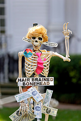30 October 2015. New Orleans, Louisiana.<br /> The Skeleton Krewe mansion on St Charles Avenue at the corner of State Street draws crowds with its satirically spooky Halloween decorations. American politics comes under fire with skeletons depicting Presidential hopeful Donald Trump as a 'Hair brined Bonehead.'<br /> Photo©; Charlie Varley/varleypix.com